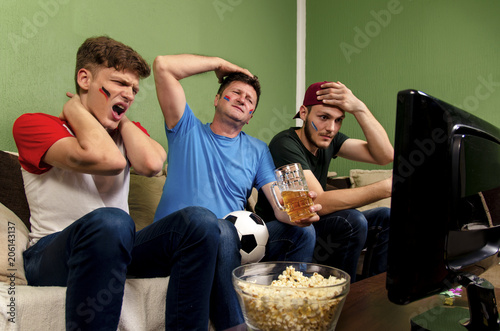Caucasian family reacting on soccer game, miss, loss, fail
