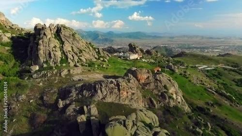 Wall mural Aerial push in to remote Treskavec monastery in spring. Prilep Macedonia