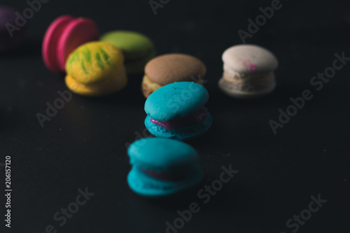 Plexiglas Macarons Macaroons on dark background, colorful french cookies macaroons.