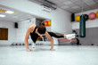 Young fit woman doing advanced strenght workout at the gym.
