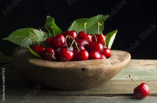 Fotobehang Kersen wooden basket with cherries
