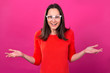 Wow! Surprised young girl with glasses on a pink background. Happy woman.