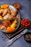 Roasted chicken with fork and knife - 206180167
