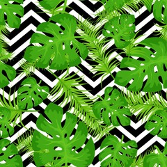 Vector seamless pattern with tropical leaves on abstract white black geometric zigzag background. Cute bright and fun summer floral background. Jungle leaf, exotic palm leaves. Vector illustration.