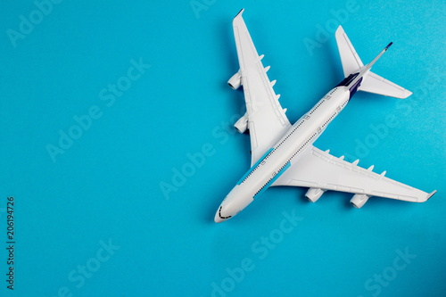 Plane, aircraft on blue background. Travel concept. Empty space for text and design