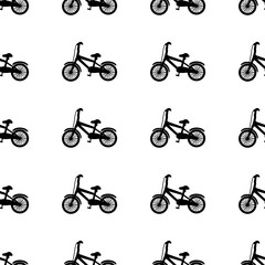 Seamless pattern with black bicycles on the white background.