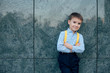 Full length portrait boy with crossed hands