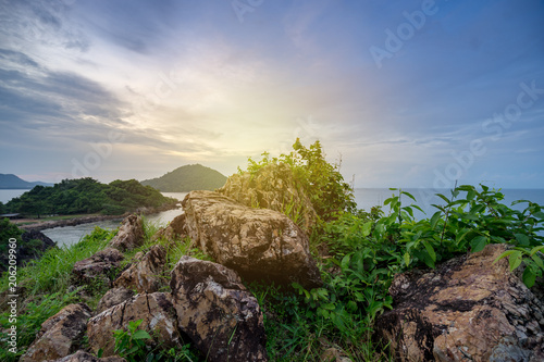 Foto Murales seascape with rock texture in morning sun light filter