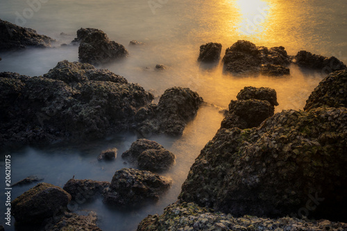 surreal of seascape between of sunset and night with long exposure