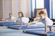 Kids exercising balancing yoga pose