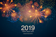 The year 2019 displayed with fireworks and strobes. New year and holidays concept.
