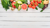 Healthy food. Vegetables and fruits. On a white wooden background. Top view. Copy space. - 206256172
