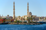 Seascape with a mosque on the shore of the harbor in the Arab city. Hurghada, Egypt - 206257763