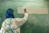Spray painting man working - 206263331