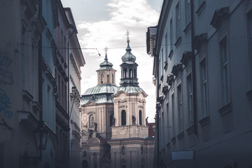 St. Nicholas Church seen through street. Stare Mesto, Prague, Czech Republic