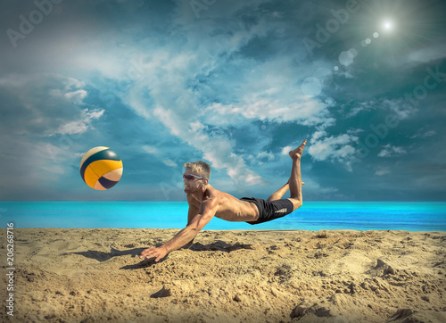 Leinwanddruck Bild Beach Volleyball player in sunglasses under sunlight.