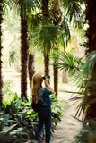 attractive young blonde tourist woman girl in beautiful jungles with camera taking photos, holiday, travel concept - 206270530