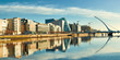 Modern buildings and offices on Liffey river in Dublin on a bright sunny day - 206273319