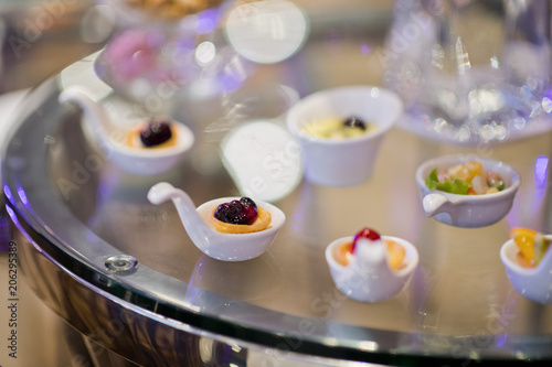 Poster Glass shots pastry, wedding catering food, mini canapes food, tasty dessert, Beautiful decorate catering banquet table,  snacks and appetizers, wedding celebration