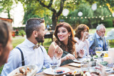 Guests eating at the wedding reception outside in the backyard. - 206309109