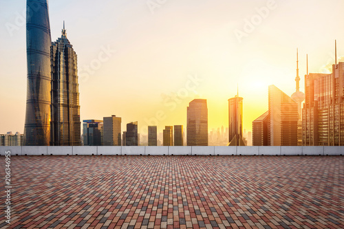 modern square and skyscrapers under sunset