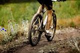 athlete cyclist dirty mountain bike biking in trail