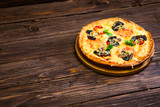 Pizza with tomato and mushrooms on a brown wooden tray - 206355580