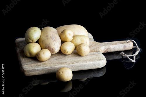 Foto Murales Patatas sobre tabla de madera