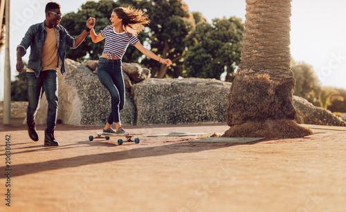 Aluminium Skateboard Woman skating on sidewalk with friend