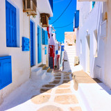Fototapeta Uliczki - Old street with white houses in Mykonos © Roman Sigaev