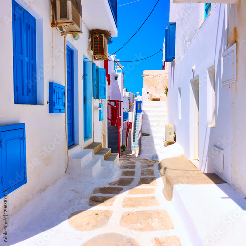 Old street with white houses in Mykonos