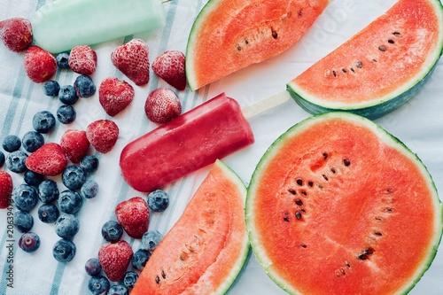 frozen fruits, vegan ice cream, fresh watermelon on white table. Summer dessert, vegetarian, detox, diet, healthy food