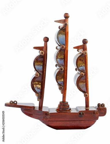 Fotobehang Schip An old wooden model ship on white background.