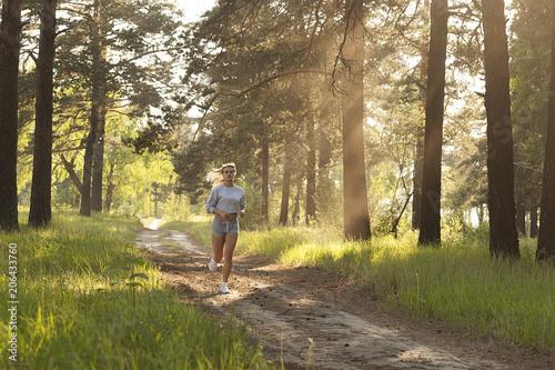 Fotobehang Hardlopen young beautiful girl running, evening jogging, sport and fitness