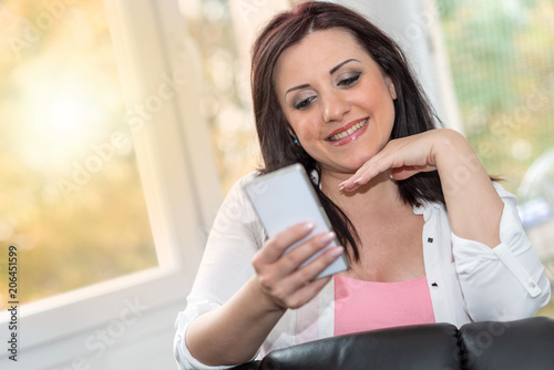 Pretty young woman using her mobile phone
