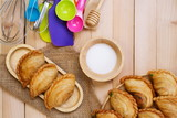 Curry puff and kitchen utensils on wooden table.Top view. - 206478722