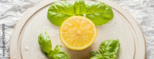 Lemon fruit slice and leaves bunch of basil