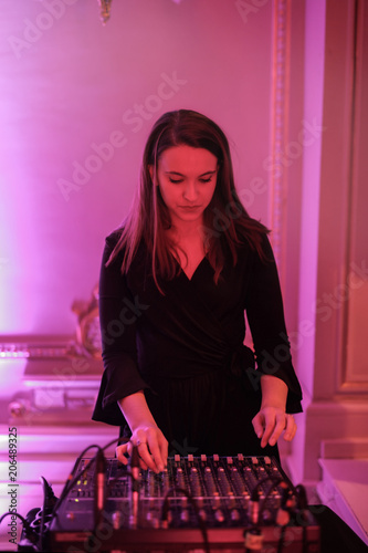 Young woman working as a deejay - 206489325