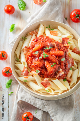 Enjoy your penne bolognese with bacon and herbs © shaiith