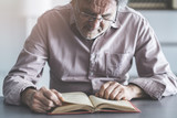 Man reading book on the table