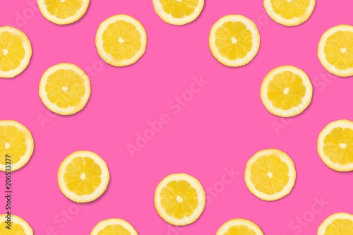 Colorful fruit frame, Lemon slices on a pastel pink background. Top view with copy space. - 206533377