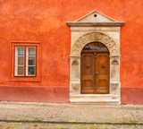 Antique entrance in a red wall - 206538169