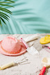 Sandy beach with towel, hat and summer accessories with copy space. Vacation and travel items. Tropical Holiday Background.