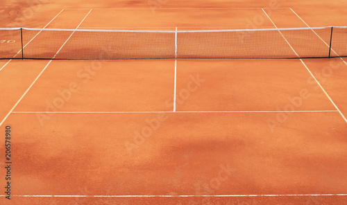 Fototapeta Clay tennis court with net and white markings