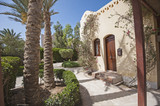 Exterior of luxury villa in tropical resort with landscaped garden - 206579953