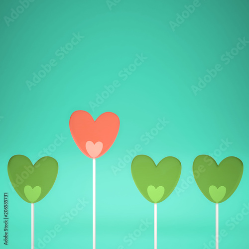Minimal love and care concept idea, green and pink heart shape candies on turquoise pastel background with copy space © ArchiVIZ