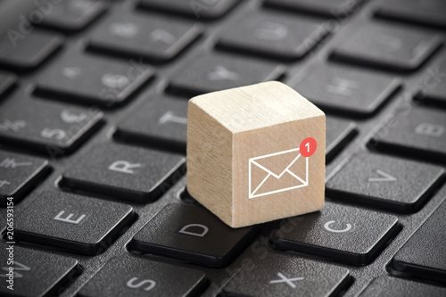 New email graphic on wooden block over laptop keyboard - 206593154