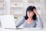 Senior woman struggling at computer - 206645345