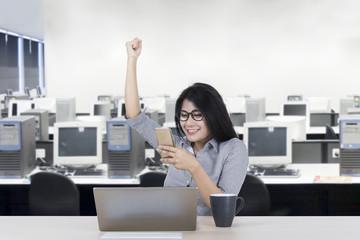 Female worker celebrating her success