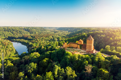 Leinwanddruck Bild aerial view to the Turaida castle and river Gauja at sunset, Latvia
